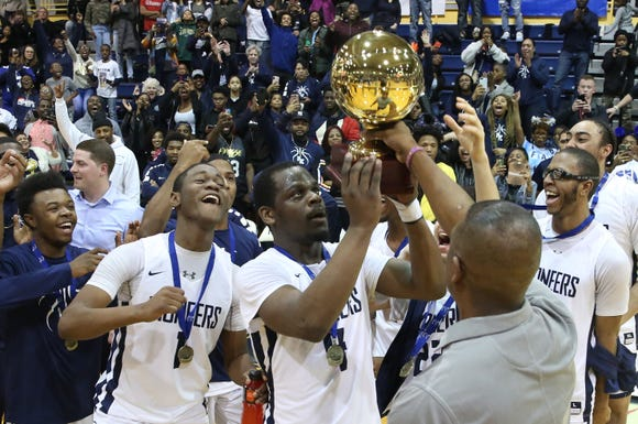 Poughkeepsie players celebrate with the gold ball after defeating Tappan Zee 47-42 in the Section 1 Class A championship game at Pace University in Pleasantville on March 2.