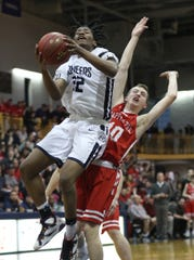 Poughkeepsie's Niyal Goins (32) goes up for a shot in front of Tappan Zee's Connor Maloney (10) during the Section 1 Class A championship game at Pace University in Pleasantville March 2, 2019. Poughkeepsie won the game 47-42.