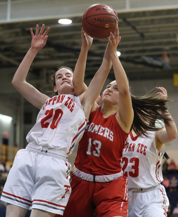 From left, Tappan Zee's Kaleigh Beirne (20) and Somers' Jordan May (13) battle for a rebound during the Section 1 Class A championship game at Pace University in Pleasantville March 2, 2019. Tappan Zee won the game 45-44.