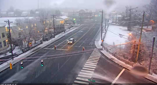 Snow begins to accumulate in the Wilmington area Sunday night.