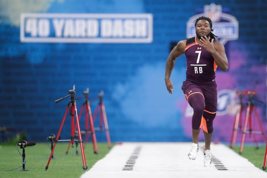 Memphis running back Darrell Henderson runs the 40-yard dash at the NFL football scouting combine in Indianapolis, Friday, March 1, 2019.