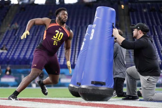 Munday's L.J. Collier goes through a drill Sunday at the NFL Combine.