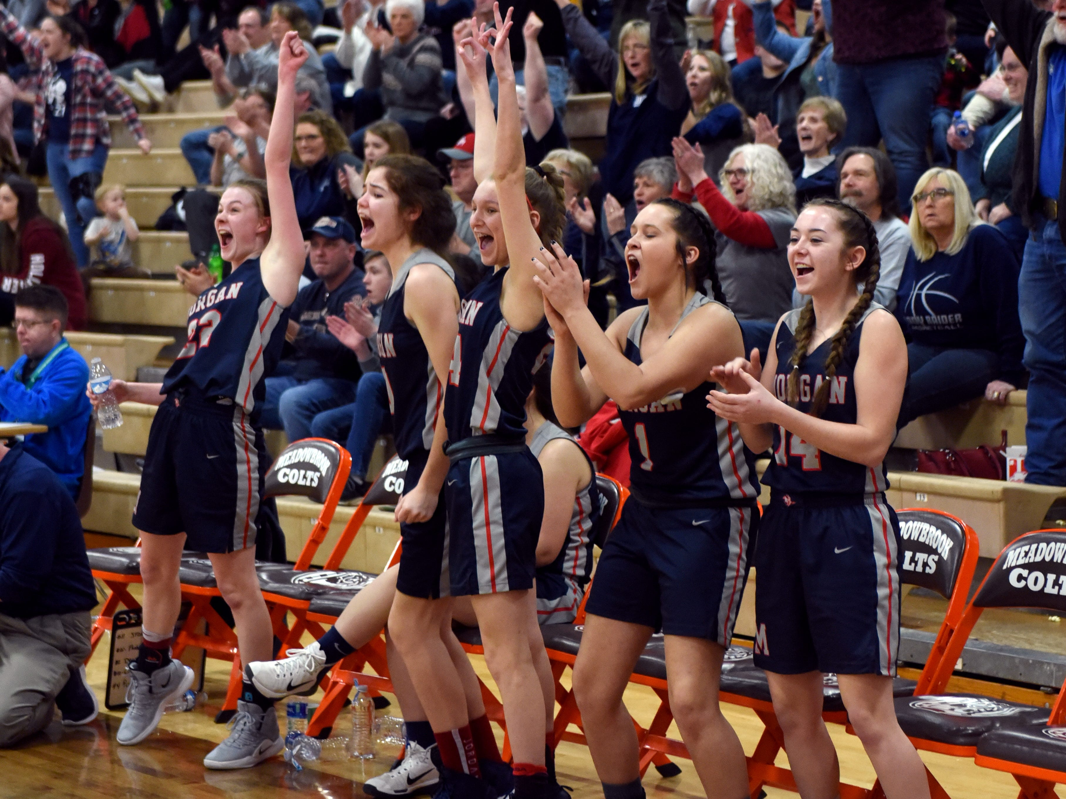 The bench celebrates a Kaylie Apperson 3-pointer during the third quarter of Morgan's 46-44 win against Bellaire on Saturday in a Division III district final at Meadowbrook High School.