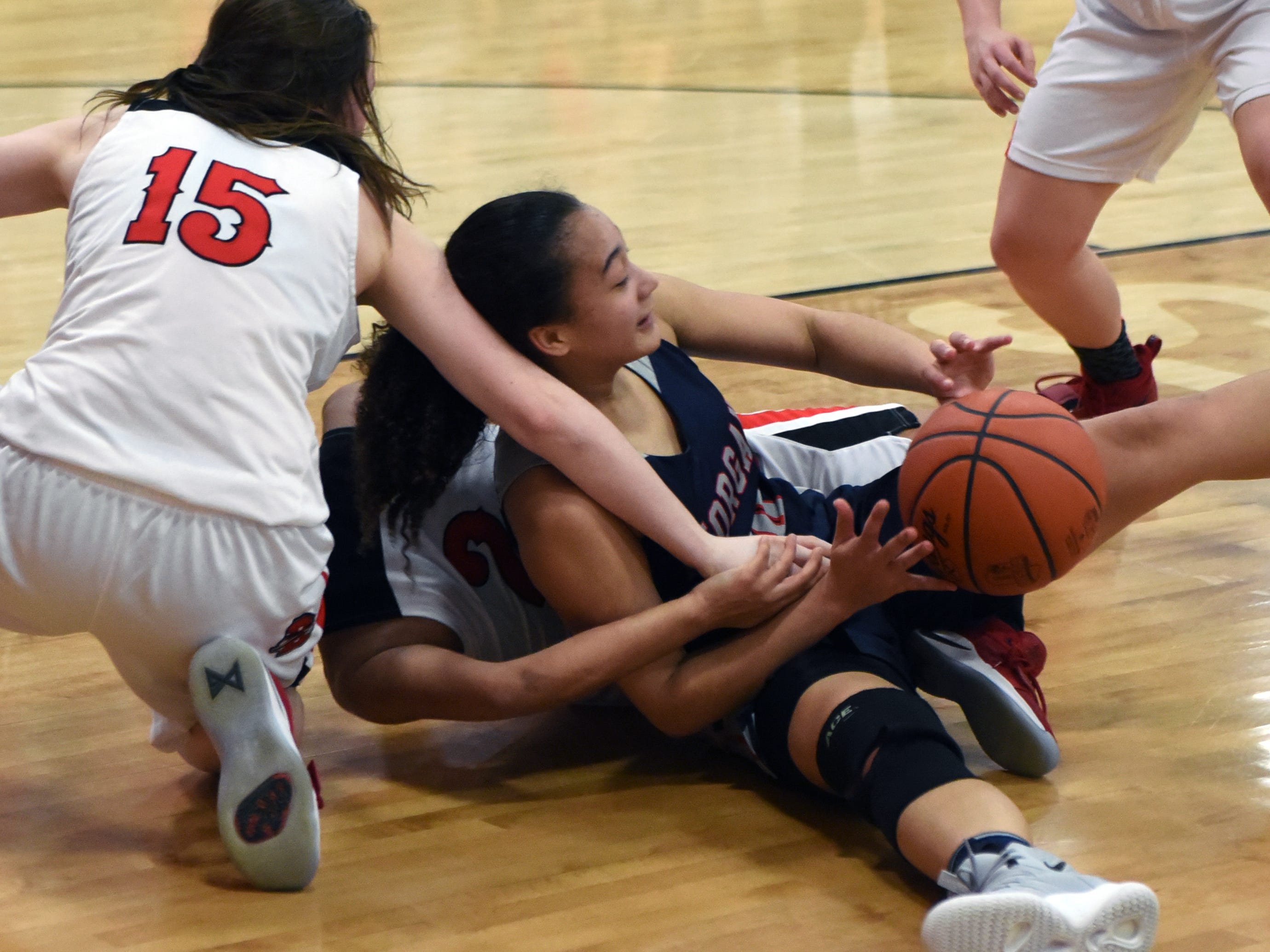 Heaven Williams emerges with a loose ball during the fourth quarter of Morgan's 46-44 win against Bellaire on Saturday in a Division III district final at Meadowbrook High School.