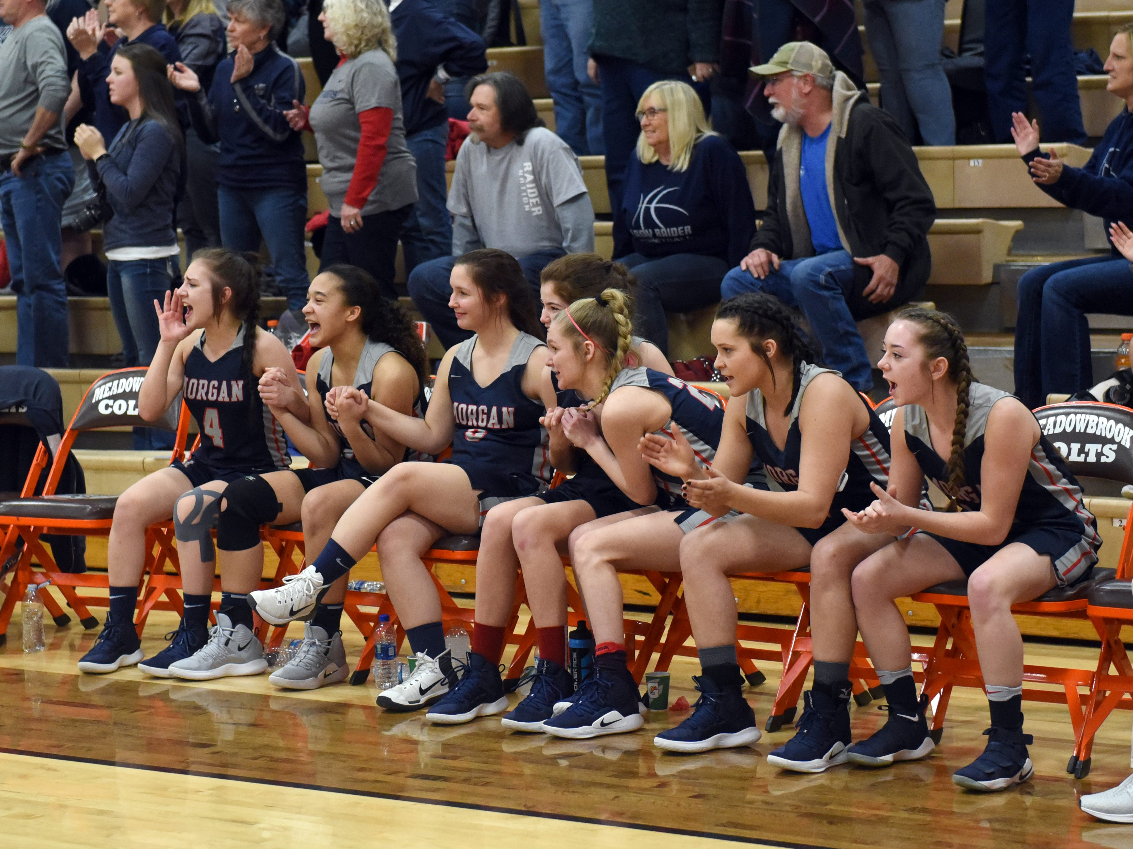 Players on the bench watch intently during the closing moments of Morgan's 46-44 win against Bellaire on Saturday in a Division III district final at Meadowbrook High School.