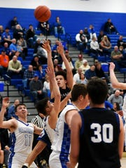 Senior Kaleb Young, of Zanesville, shoots a jumper in the third quarter against Cambridge in a Division III sectional final at Gene Ford Gymnasium. Cambridge won, 47-36.
