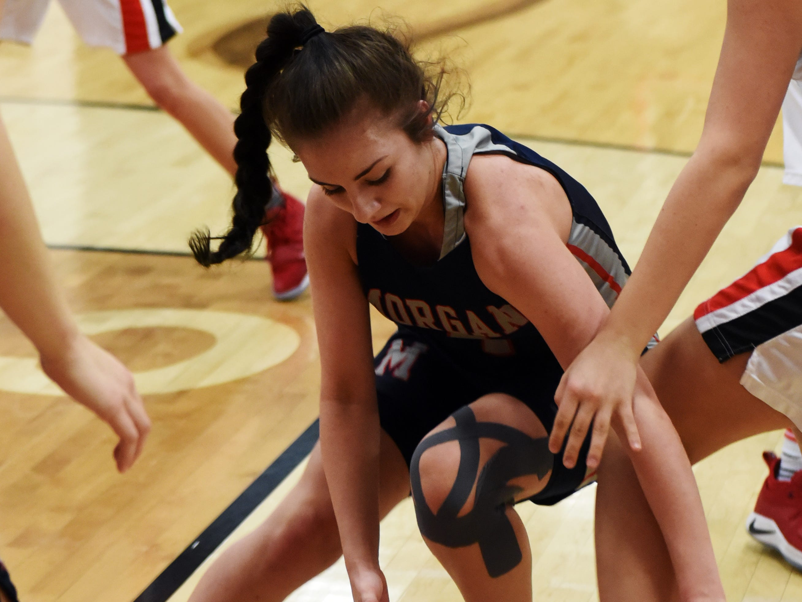 Morgan's Avery Dilleha goes after a loose ball against Bellaire.
