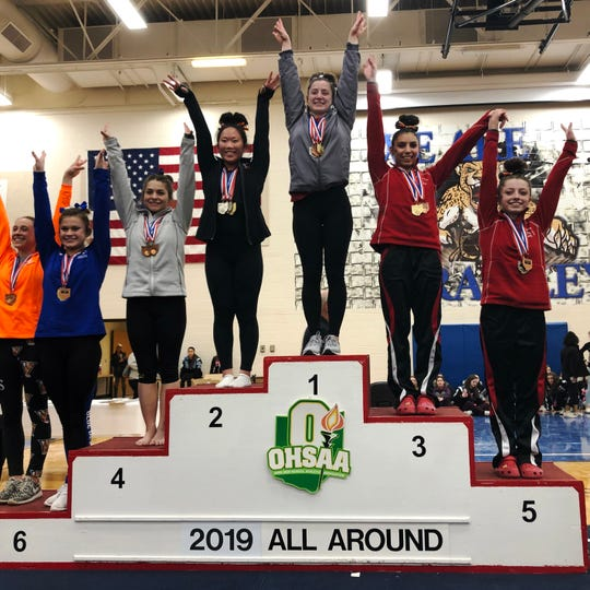 Sheridan's Sydney Bradley stands atop the podium after winning the individual all-around title at Saturday's state gymnastics meet at Hilliard Bradley.