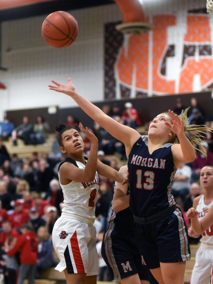 Bellaire's Katrina Davis, left, and Morgan's Riley Coon fight for a rebound during the Raiders' 46-44 win on Saturday in a Division III district final at Meadowbrook High School.