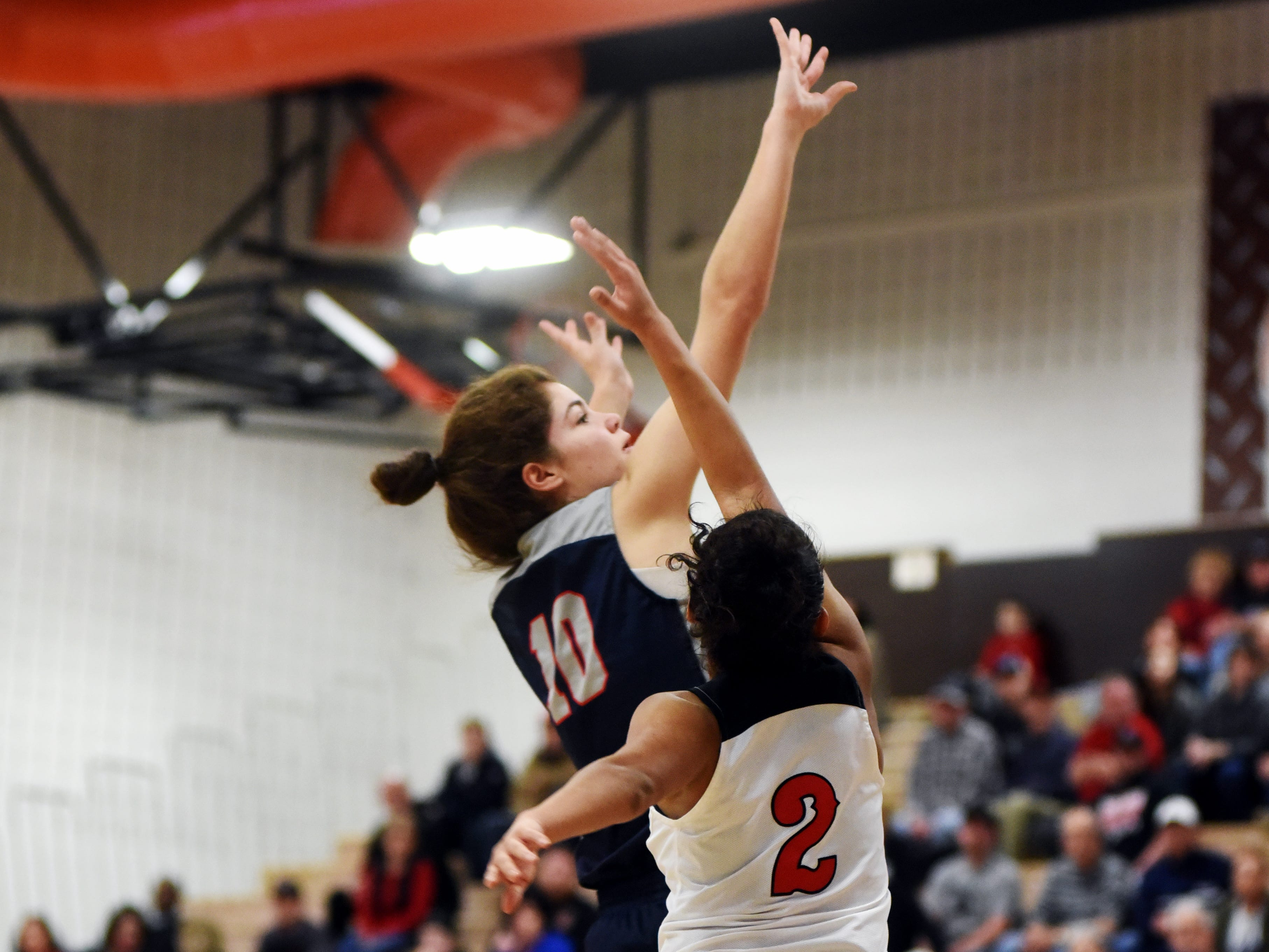 Katie Hook, of Morgan, takes a shot in the lane over Bellaire's Katie Davis.