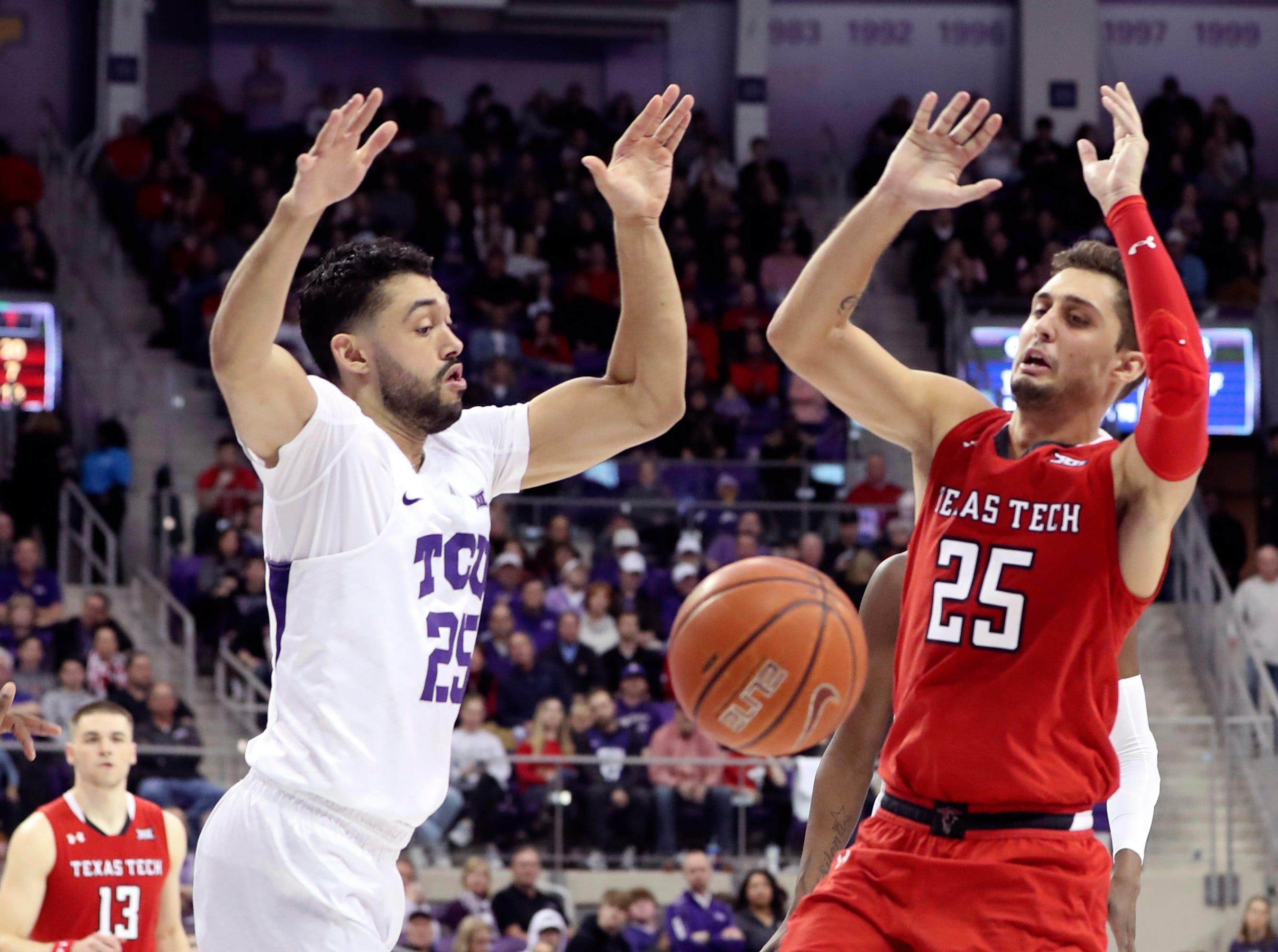March 2: TCU guard Alex Robinson, left, and Texas Tech  guard Davide Moretti go for a loose ball.