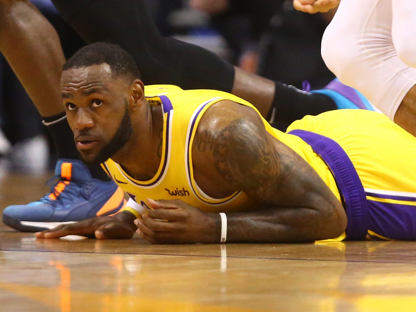 March 2: Lakers forward LeBron James falls to the floor during a dispiriting loss to the league-worst Suns in Phoenix.
