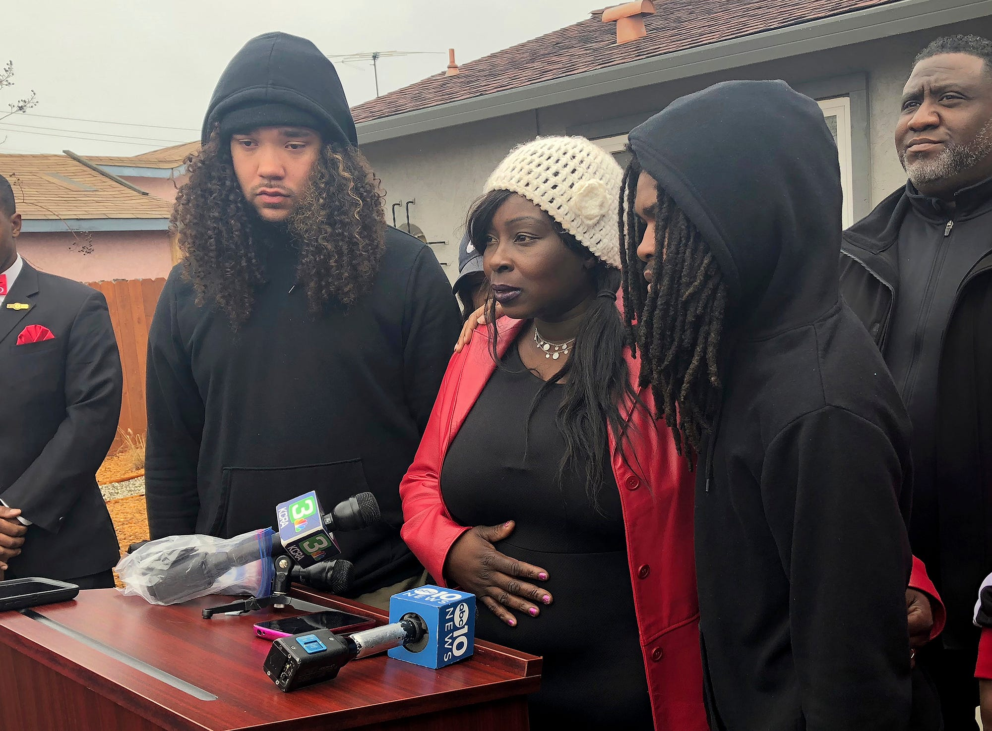 Sequette Clark, center, the mother of police shooting victim Stephon Clark, discusses the decision not to prosecute the two Sacramento Police officers involved, during a news conference in Sacramento, Calif., Saturday, March 2, 2019.