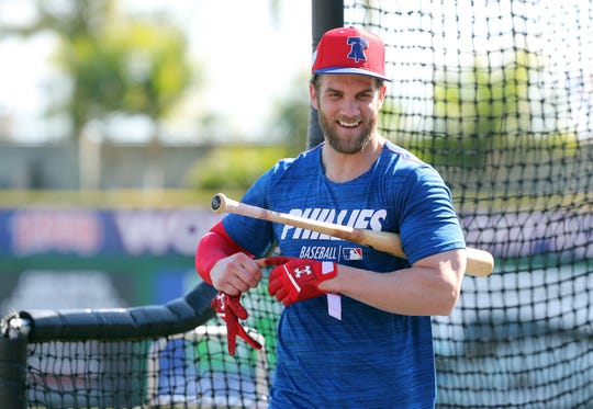 Phillies right fielder Bryce Harper works out during batting practice at spring training.