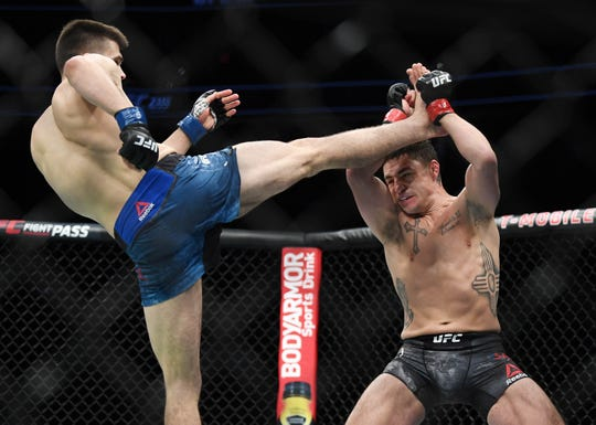 Diego Sanchez (red gloves) and Mickey Gall (blue gloves) during UFC 235 at T-Mobile Arena.