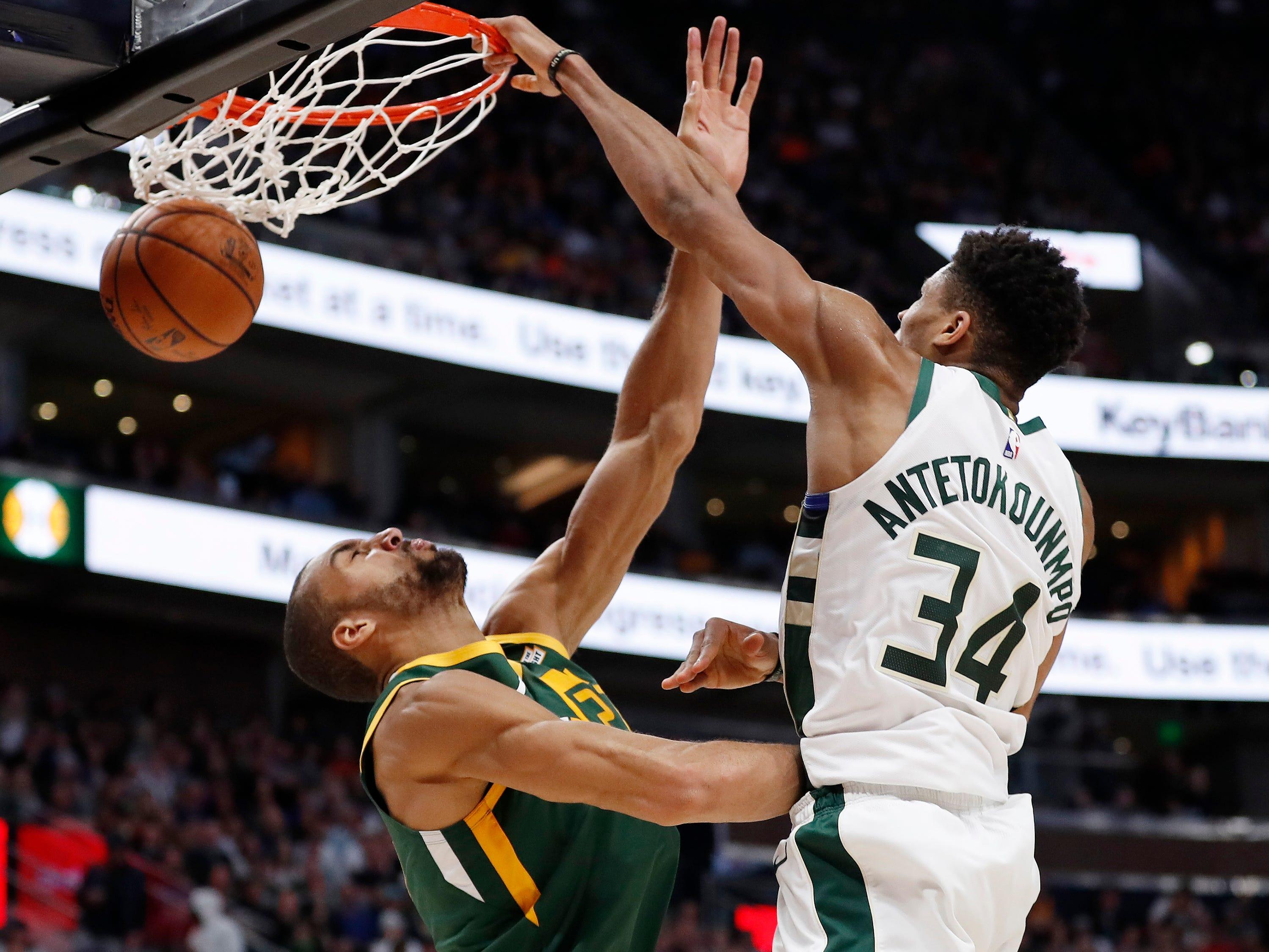 March 2: Bucks forward Giannis Antetokounmpo (34) finishes the thunderous flush over Jazz center Rudy Gobert (27) during the fourth quarter in Salt Lake City.