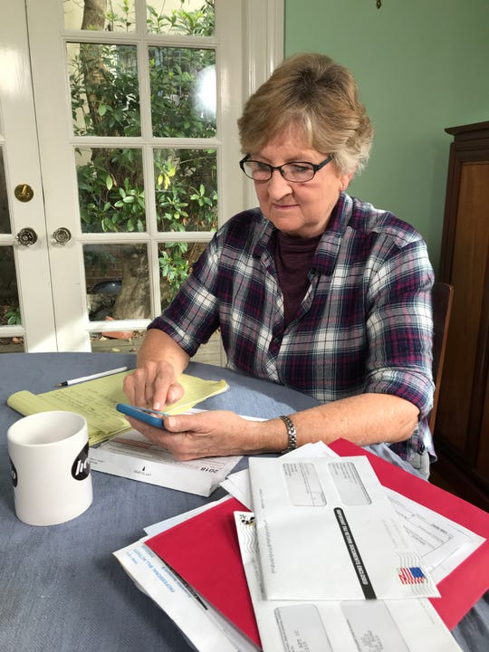 Gypsy Jolly using her iPhone and the TurboTax Live app to prepare her taxes.