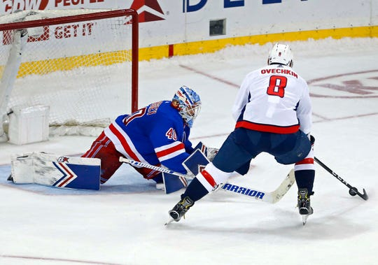 Rangers goaltender Alexandar Georgiev loses his stick against  Capitals left wing Alex Ovechkin during the shootout Sunday.