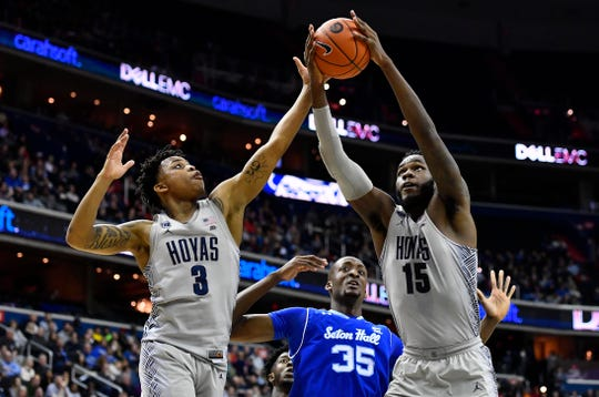 Georgetown Hoyas guard James Akinjo (3) and center Jessie Govan (15) rebound in front of Seton Hall Pirates center Romaro Gill (35).