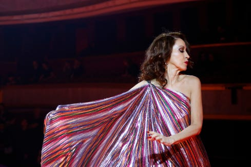 Pat Cleveland walked the runaway in a boldly striped, one-shoulder gown for Tommy Hilfiger during Paris Fashion Week.