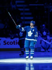 Toronto Maple Leafs forward John Tavares acknowledges the fans' standing ovation for him at Saturday's game.
