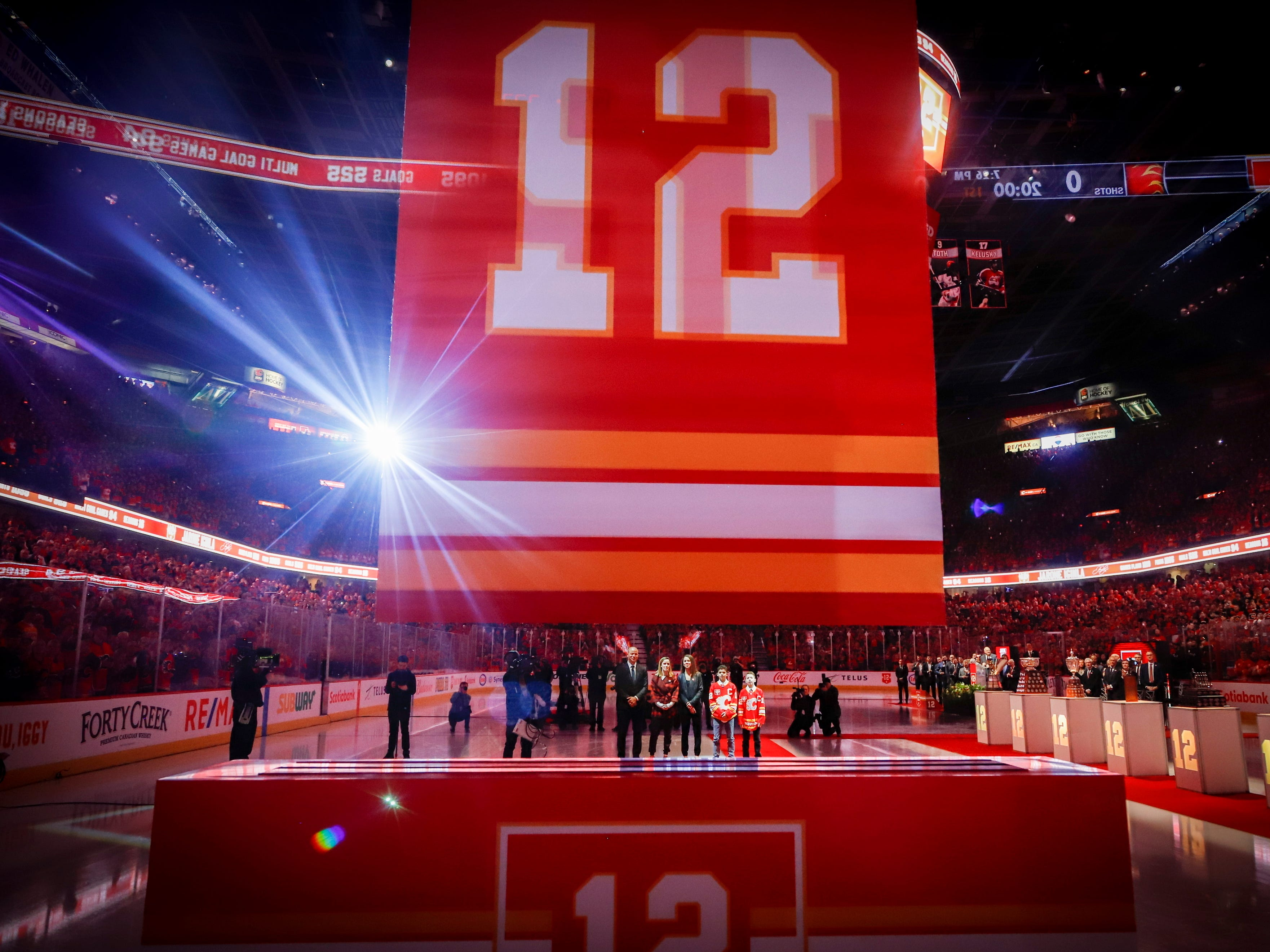 March 2: Former Calgary Flames captain Jarome Iginla and his family watch as his No. 12 jersey is retired.