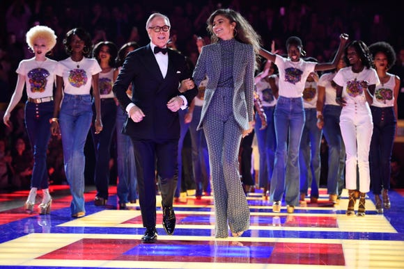 Tommy Hilfiger and Zendaya take a triumphant lap on the catwalk after presenting their collection at Paris Fashion Week.