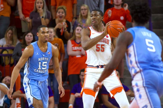 Clemson Tigers center Trey Jemison (55) looks to pass the ball while being defended by North Carolina Tar Heels forward Garrison Brooks (15).