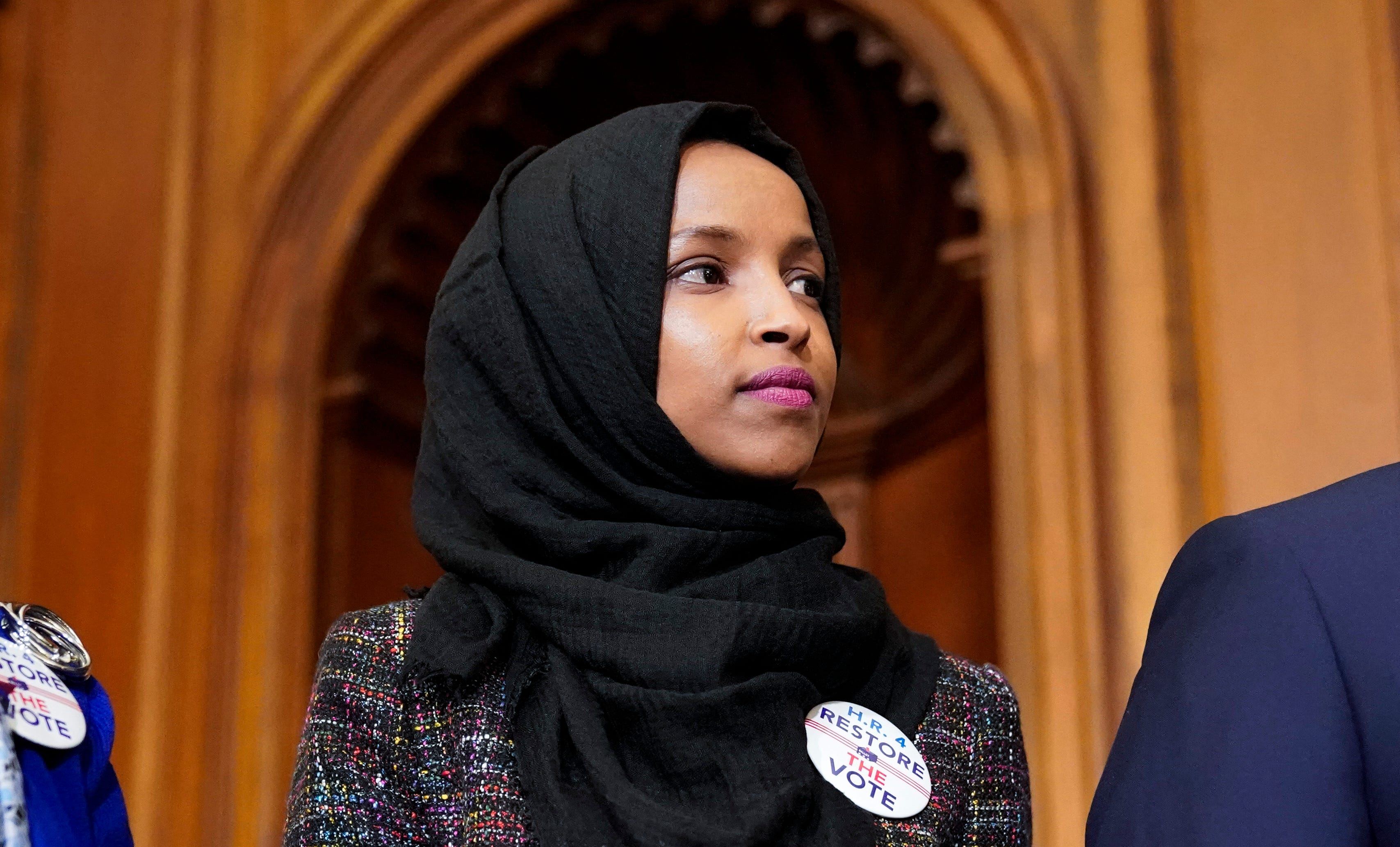 Rep. Ilhan Omar, D-Minn., joins lawmakers to speak about the Voting Rights Enhancement Act on Feb. 26, 2019.