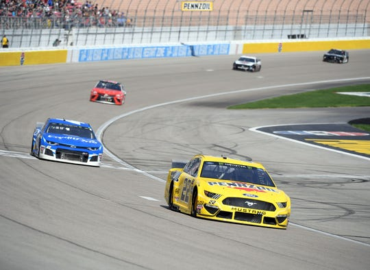 Joey Logano, front, scored his 22nd career NASCAR Cup Series win Sunday at Las Vegas Motor Speedway.