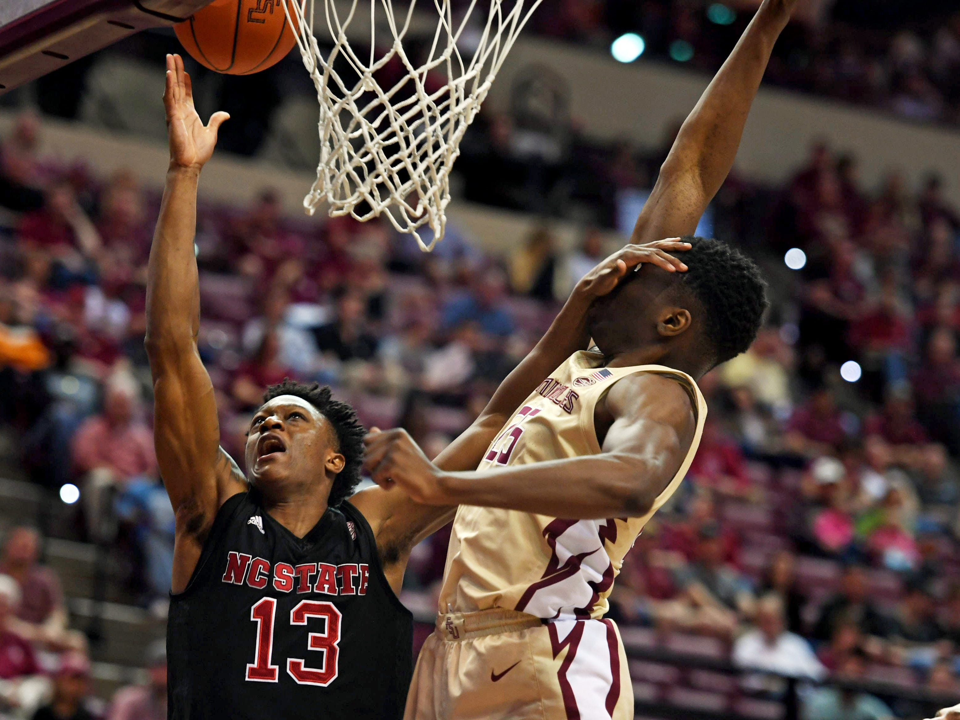 March 2: Florida State forward Mfiondu Kabengele gets a hand in his face as he defends against North Carolina State guard CJ Bryce.