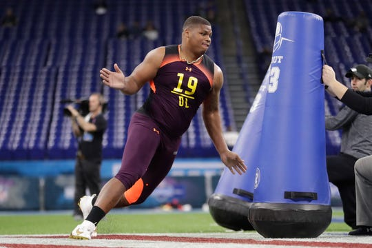 Alabama defensive lineman Quinnen Williams runs a drill at the NFL football scouting combine in Indianapolis, Sunday, March 3, 2019.