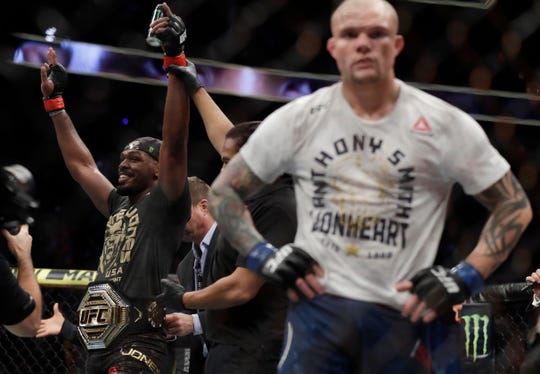 Jon Jones celebrates after defeating Anthony Smith following their light heavyweight title bout during UFC 235.