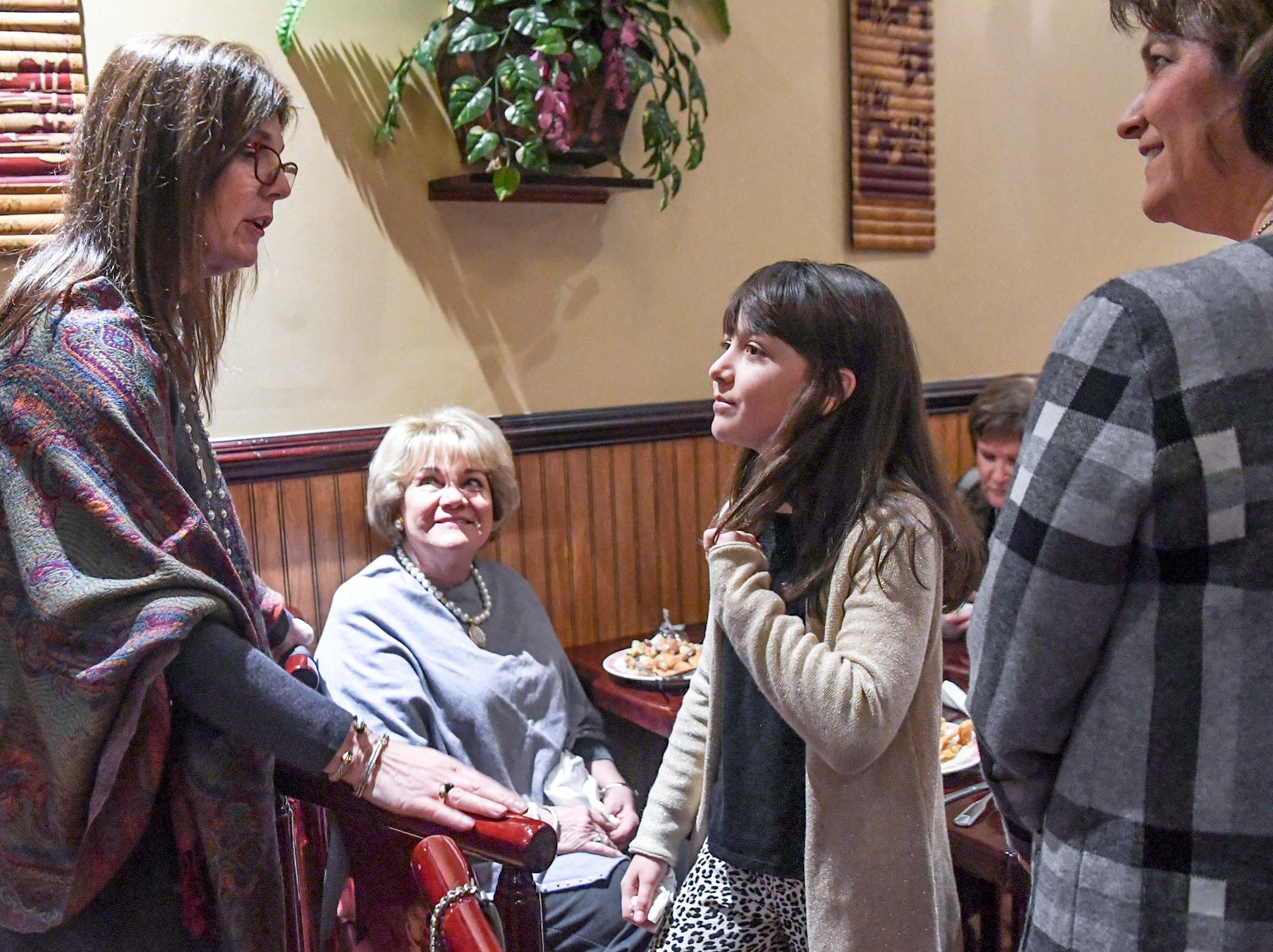 State Lt. Gov. Pamela Evette, left, meets Meri Drake  Venterella, 11, of Anderson, her mother Meridith, right, and grandmother Mariah Moorhead, middle left, before speaking at the 1st Monday Club at Master's Wok in Anderson Monday.