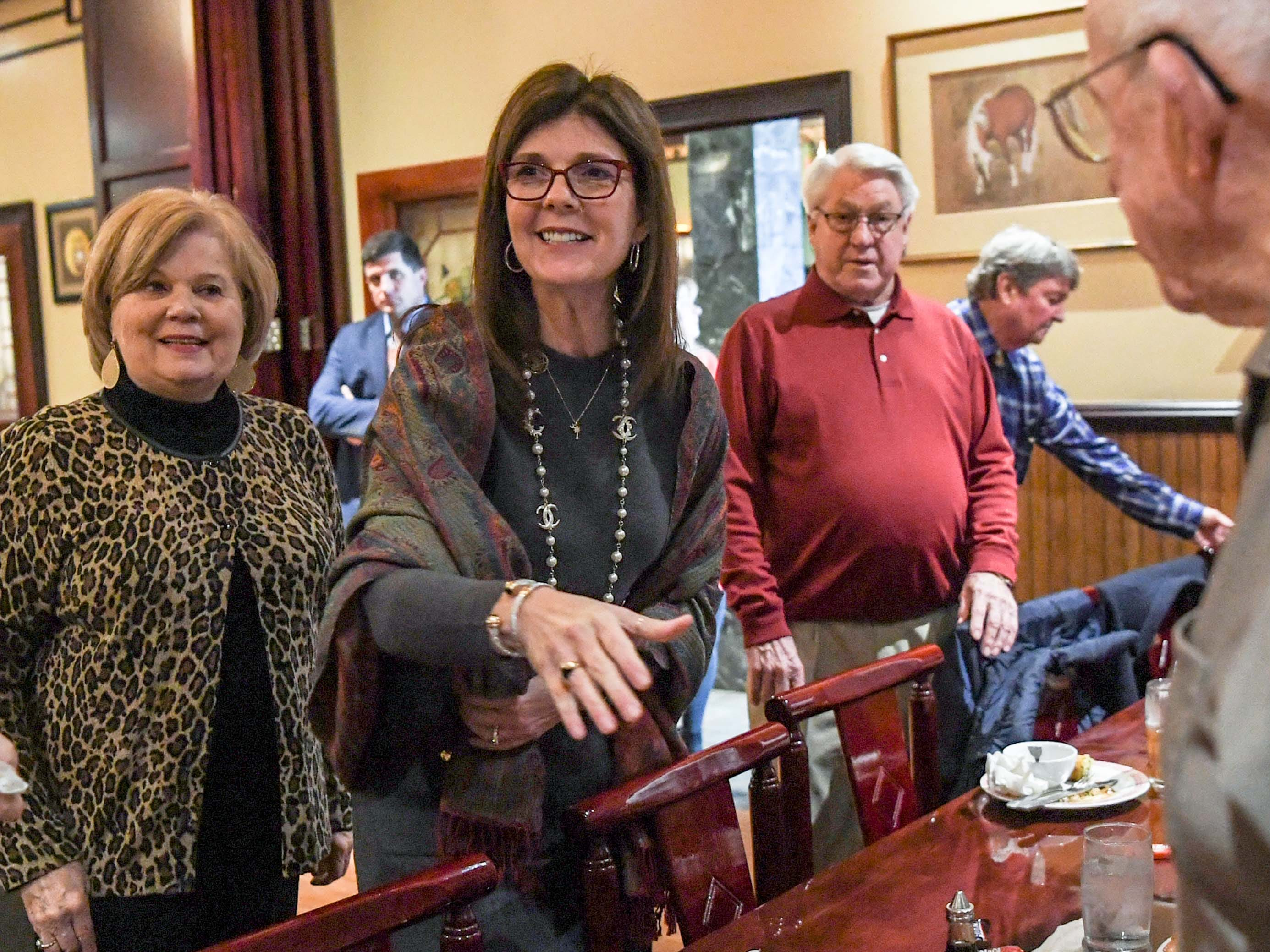 State Lt. Gov. Pamela Evette, middle, shakes hands with visitors at the 1st Monday Club at Master's Wok in Anderson Monday.
