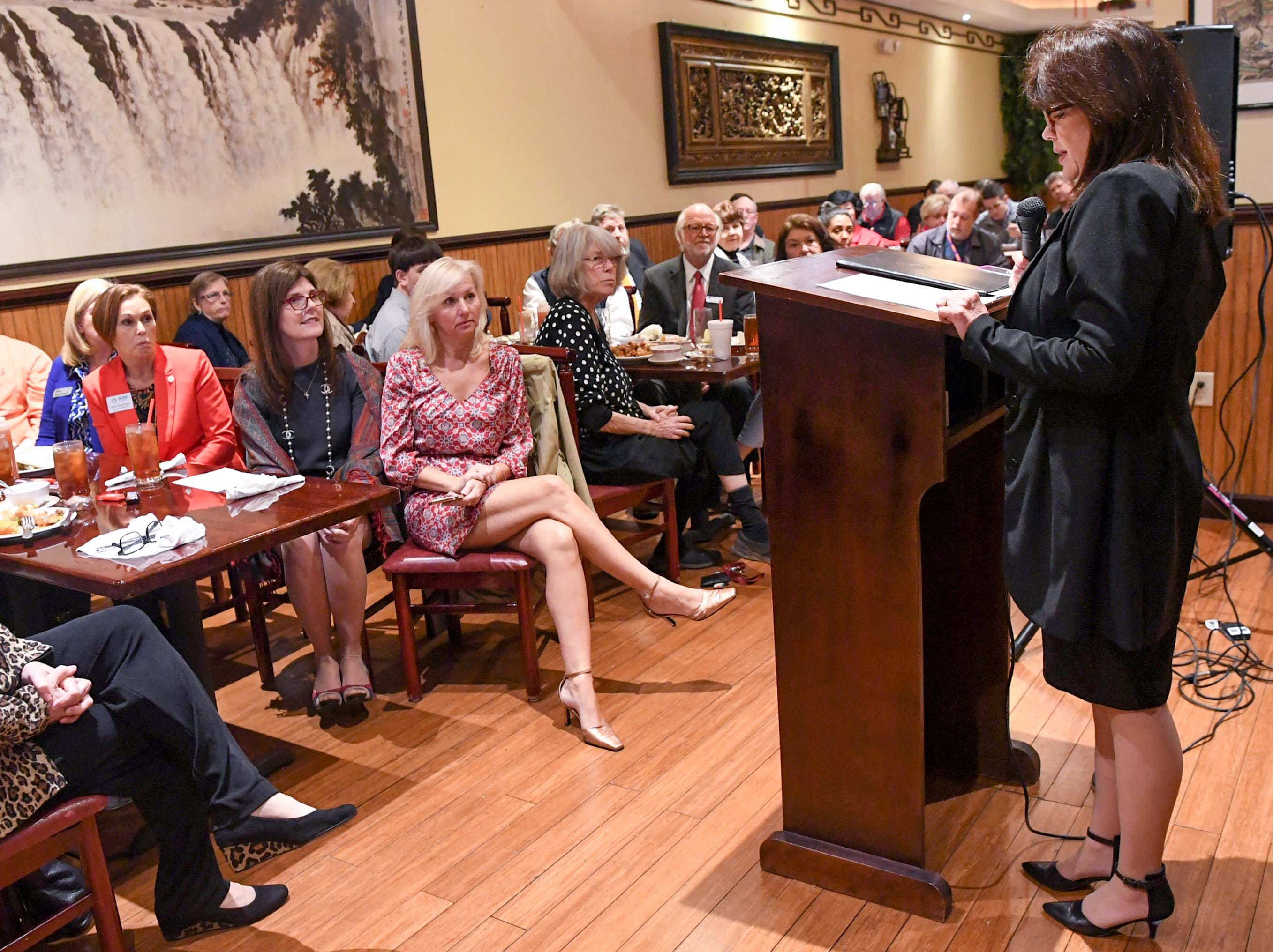 State Rep. Anne Thayer, right, Anderson House District 9, introduces State Lt. Gov. Pamela Evette, seated in middle on left, at the 1st Monday Club at Master's Wok in Anderson Monday.