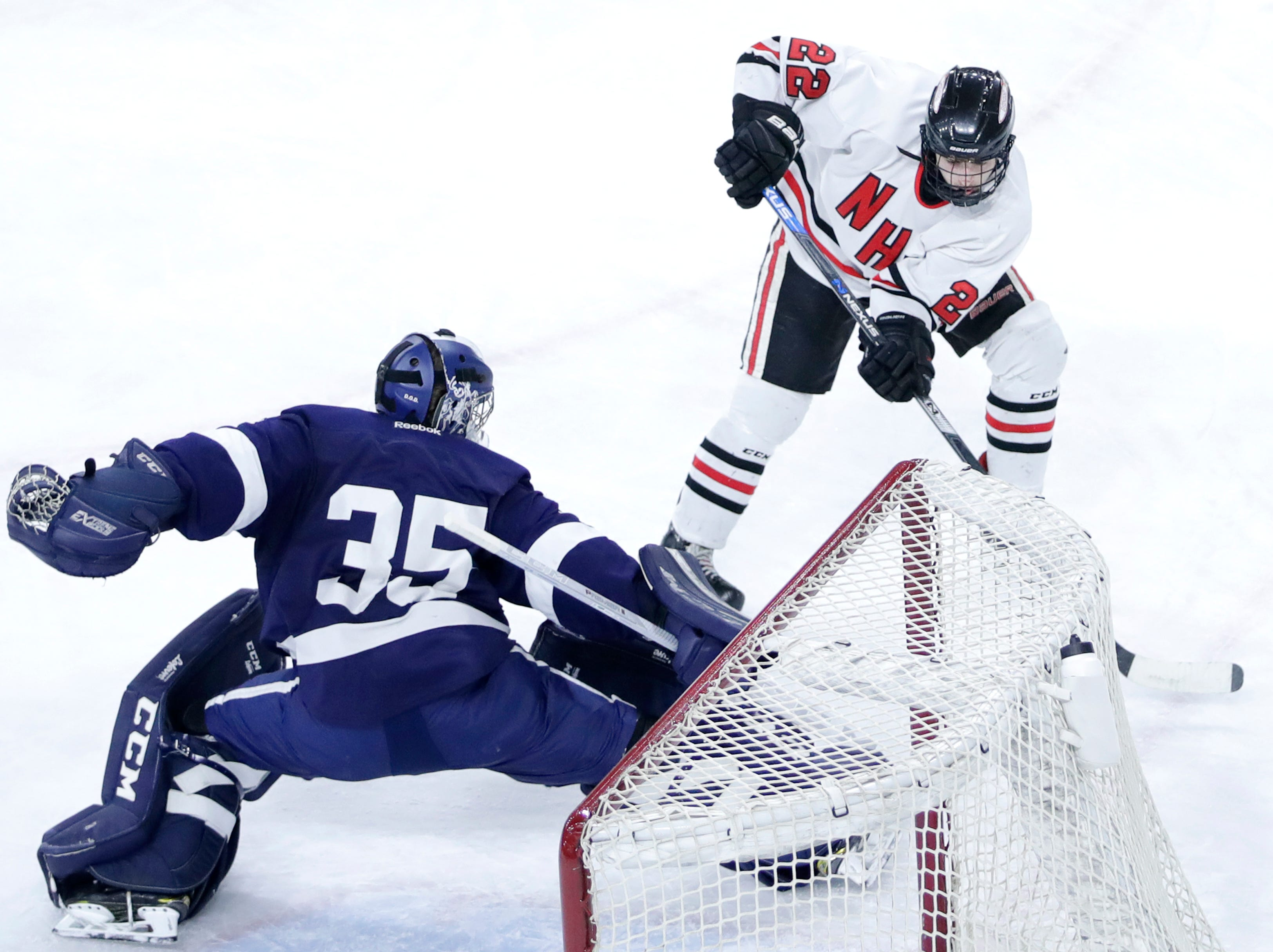 Neenah/Hortonville/MenashaÕs Mason Marquardt gets the puck past HudsonÕs Alex Cohen during the WIAA State Hockey Tournament quarterfinals Thursday, Feb. 28, 2019, at Veterans Memorial Coliseum in Madison, Wis.