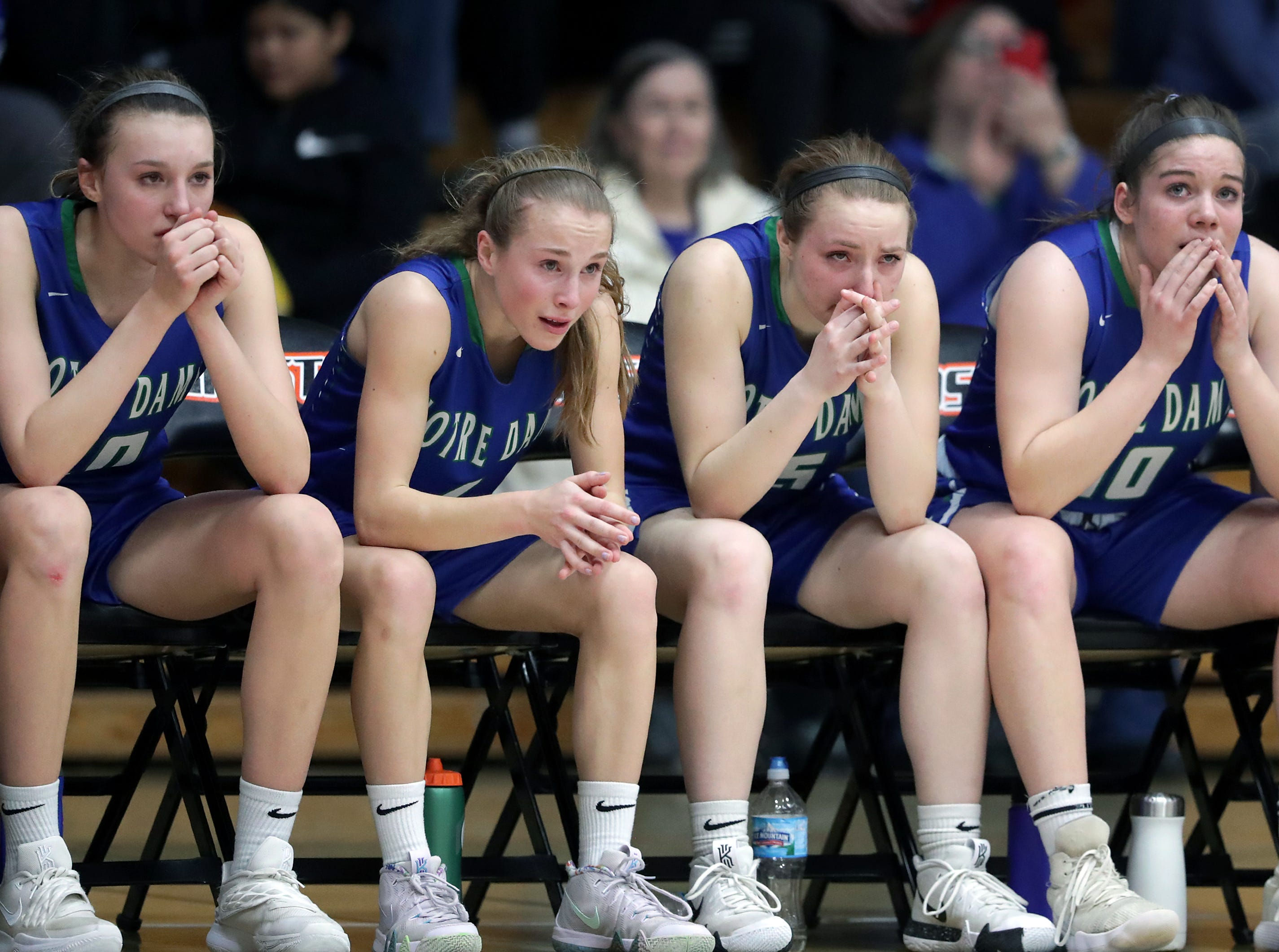 Notre Dame High School players react in the final seconds against Beaver Dam High School during their WIAA Division 2 girls basketball sectional final on Saturday, March 2, 2019, at Kaukauna High School in Kaukauna, Wis. Beaver Dam defeated Notre Dame 68 to 40.