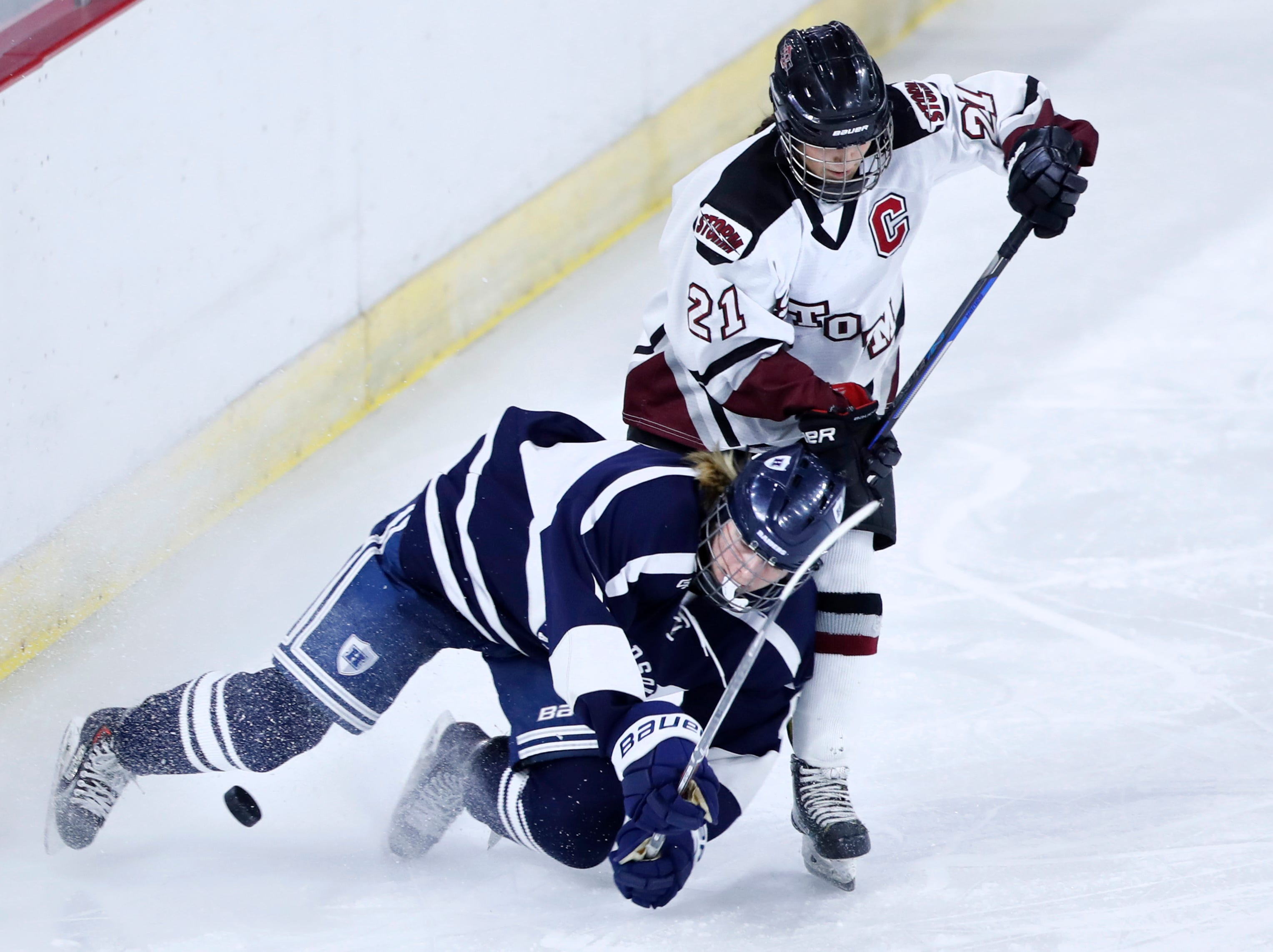 D.C. Everest Co-opÕs Kiley Hahner is blocked from the puck as HudsonÕs Kennedy Hendricks falls infront of her during the WIAA State Hockey Tournament semifinals Friday, March 1, 2019, at Veterans Memorial Coliseum in Madison, Wis.