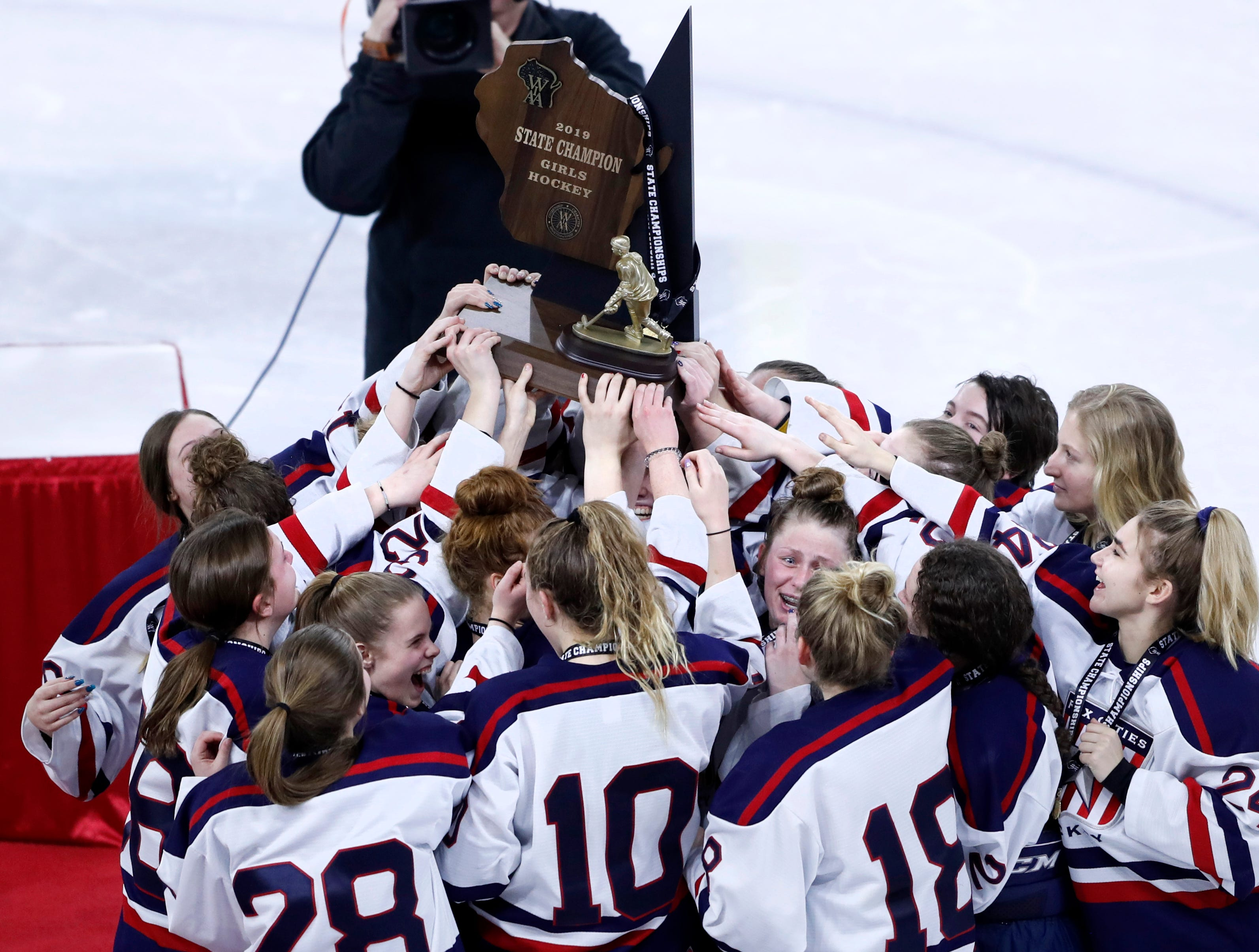 Fox Cities Stars players hold up the first place trophy after defeating Hudson in double overtime Saturday, March 2, 2019, at Veterans Memorial Coliseum in Madison, Wis.