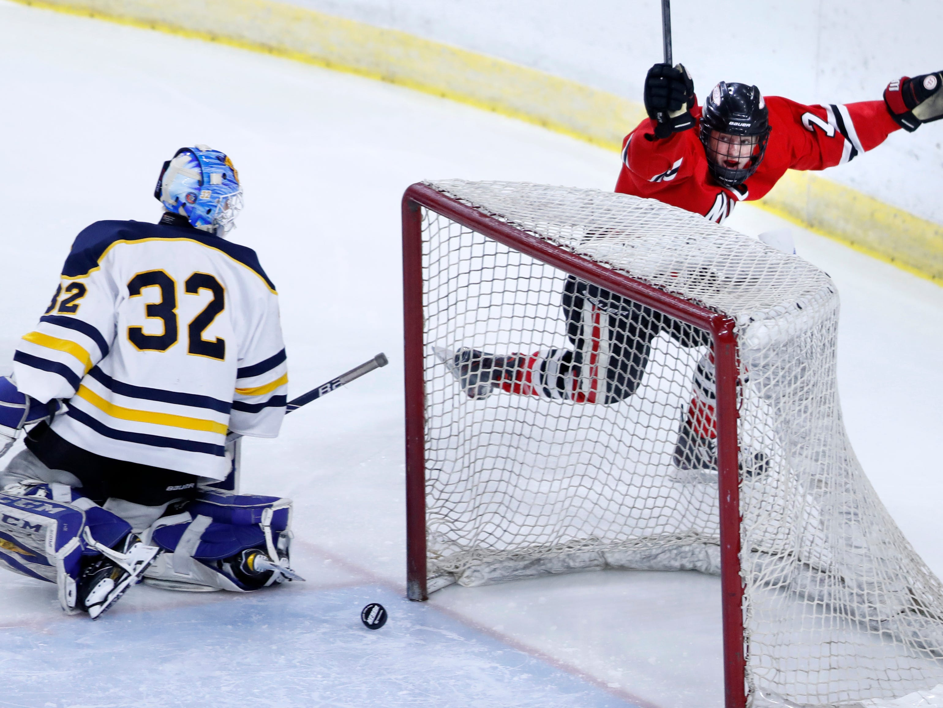 Neenah/Hortonville/MenashaÕs Ethan Long scores on University School of MilwaukeeÕs Patrick Kelly during the WIAA State Hockey Tournament championship match Saturday, March 2, 2019, at Veterans Memorial Coliseum in Madison, Wis.
