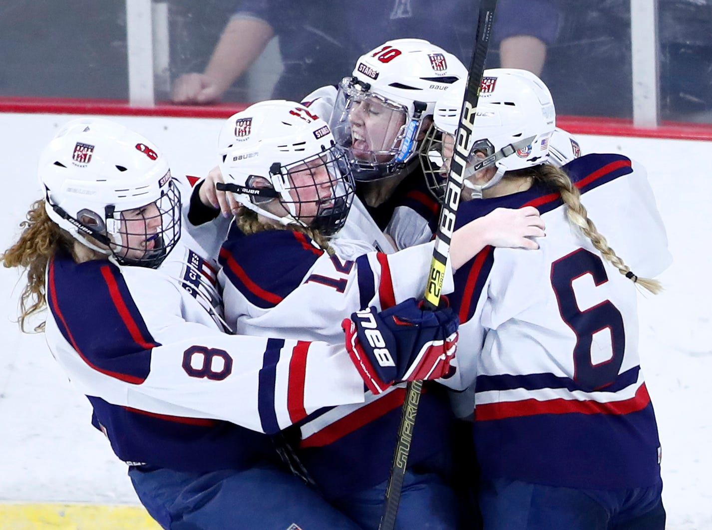 Fox Cities StarsÕ Tori Nelson (8), Annika Horman (12), and Lauryn Hull (6) rush into Maddy Jablonski (10) after she scored the game winning goal against Hudson in double overtime during the WIAA State Hockey Tournament championship match Saturday, March 2, 2019, at Veterans Memorial Coliseum in Madison, Wis.