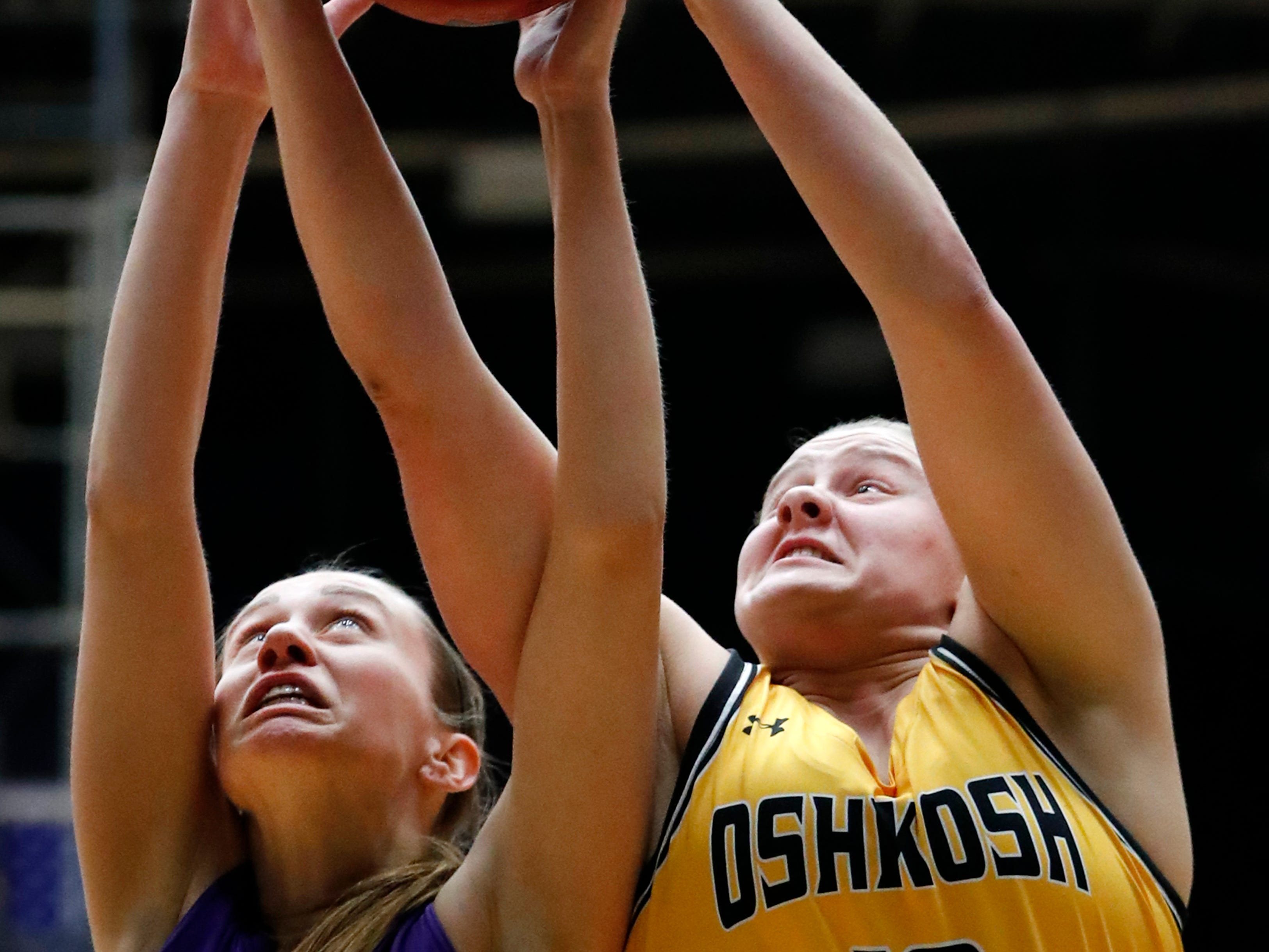 UW-WhitewaterÕs Megan Corcoran (20) fights for control of a rebound with UW-OshkoshÕs Leah Porath (12) during the WIAC Championship final Sunday, Feb. 24, 2019, at the Kolf Sports Center in Oshkosh, Wis.