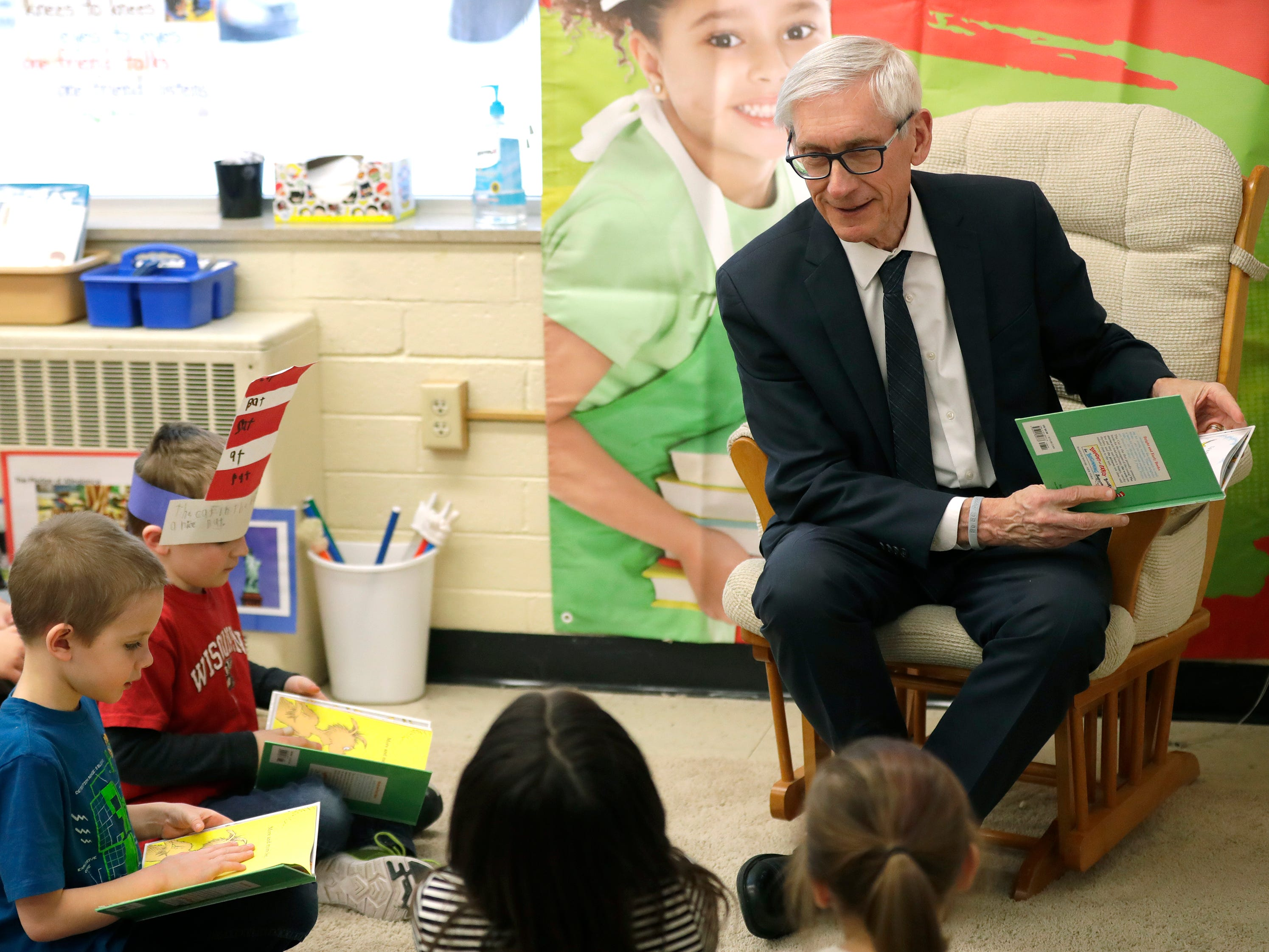 Gov. Tony Evers reads a Dr. Seuss book to third-grade students Friday, March 1, 2019, at Lincoln Elementary School in Appleton, Wis.