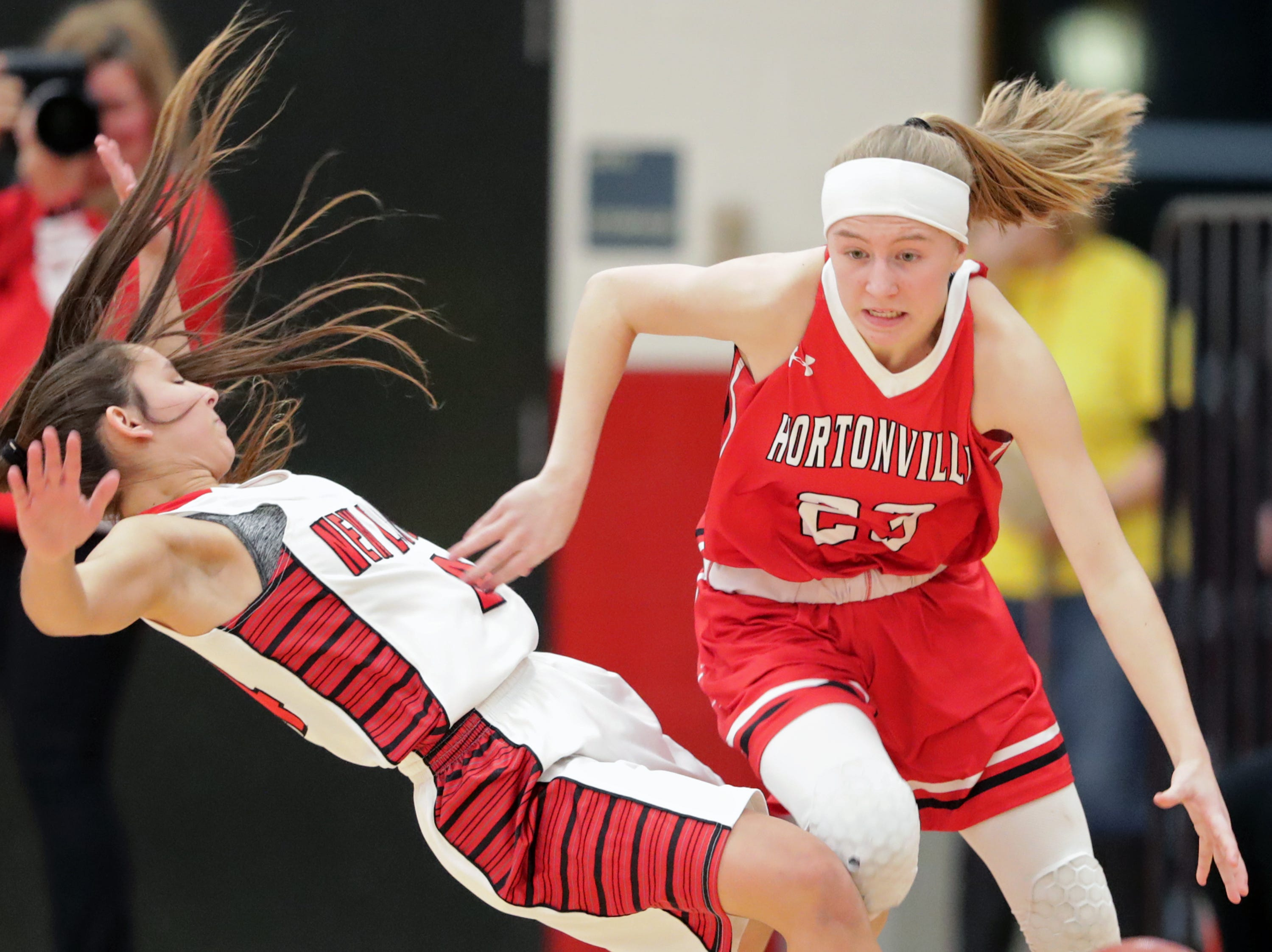 Hortonville High School's #23 Kamy Peppler against New London High School's #24 Samantha Pfefferle during their WIAA Division 2 girls basketball sectional semifinal gameThursday, February 28, 2019, at Kimberly High School in Kimberly, Wis. Hortonville defeated New London 67 to 42.
