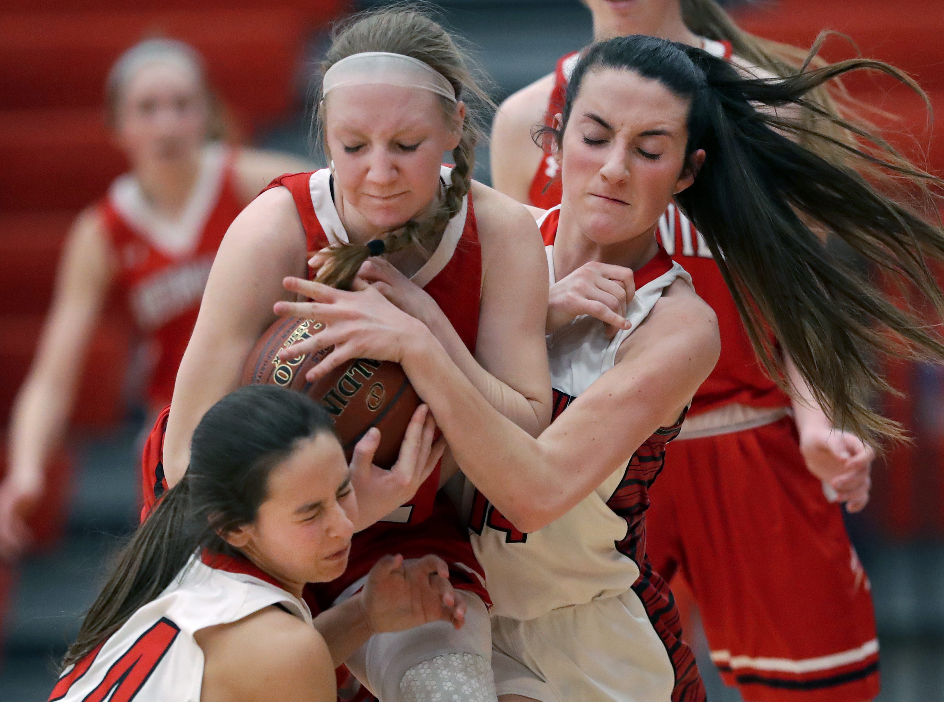 Hortonville High School's #12 Morgan Draheim against New London High School's #24 Samantha Pfefferle and #14 Mehgan Besaw during their WIAA Division 2 girls basketball sectional semifinal gameThursday, February 28, 2019, at Kimberly High School in Kimberly, Wis. Hortonville defeated New London 67 to 42.