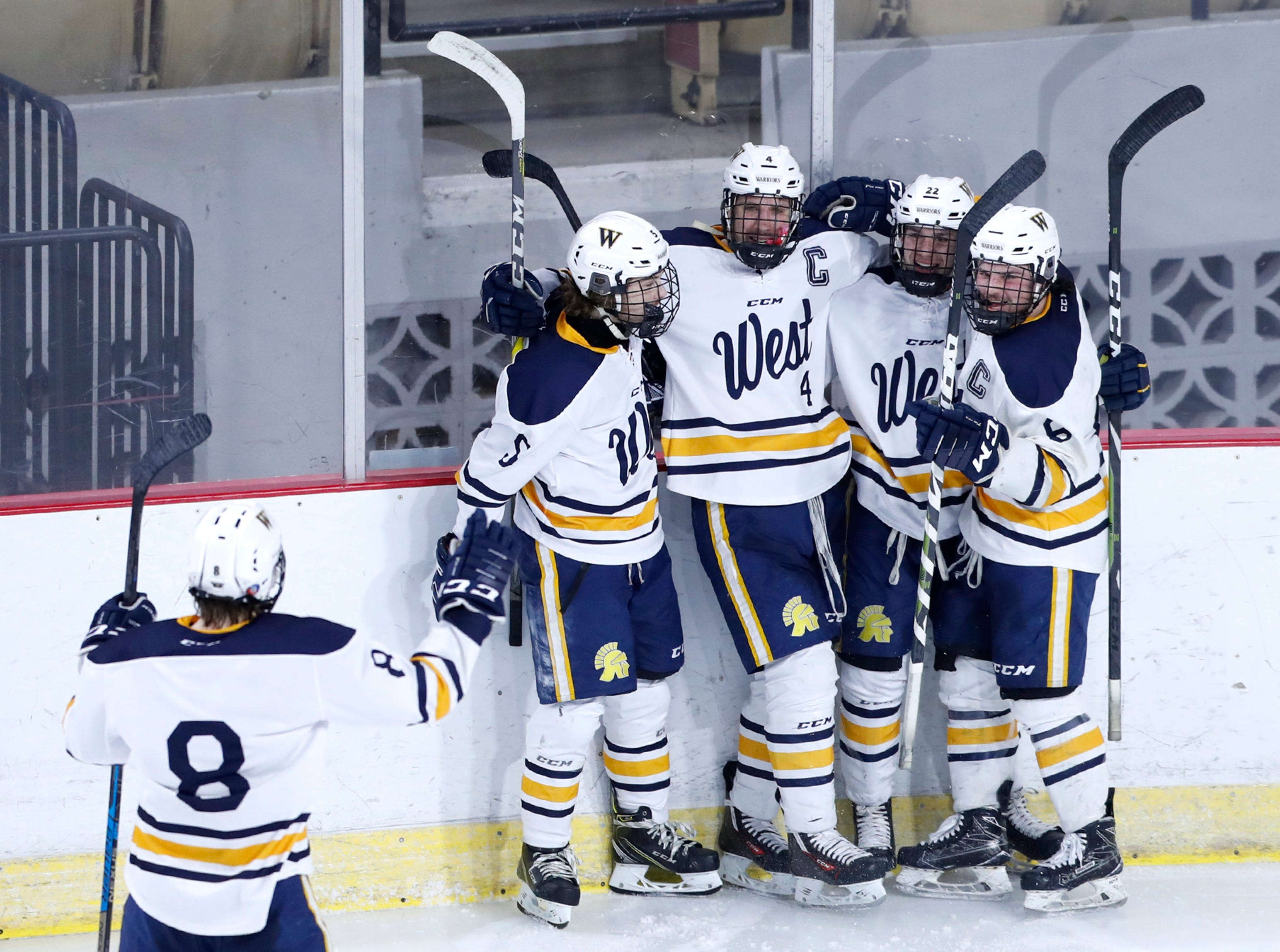 Wausau WestÕs Connor Healy goes to celebrate with teammates after a goal scored by Sam Techel against Waukesha North Co-op during the WIAA State Hockey Tournament quarterfinals Thursday, Feb. 28, 2019, at Veterans Memorial Coliseum in Madison, Wis.