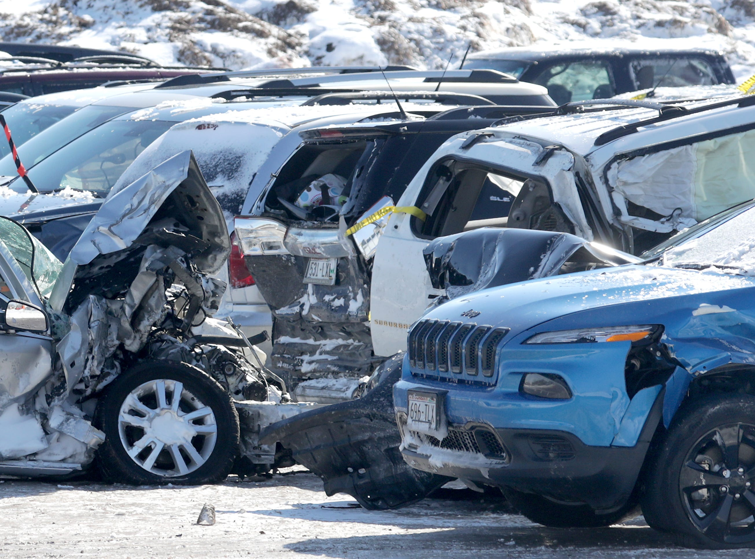 "Vehicles are stored in a lot at the Neenah city garage on Monday, February 25, 2019, in Neenah Wis. The vehicles were towed to the lot aftrer one person was killed and dozens of drivers were stranded following a pileup of more than 100 cars on Interstate 41 on Sunday, February 24, 2019. Whiteout conditions caused the ""chain reaction crash"" at 11:10.