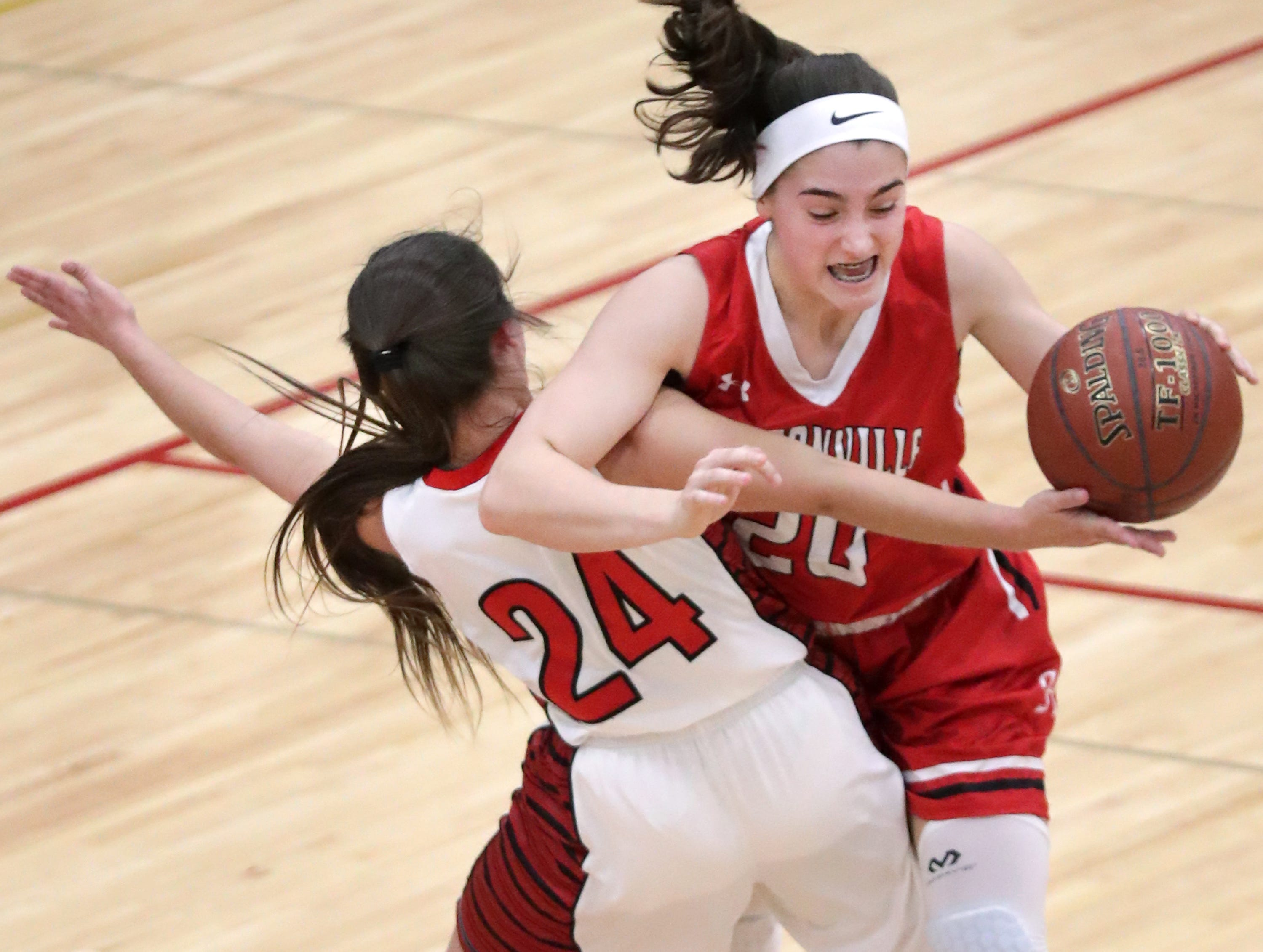 Hortonville High School's #20 Lyric Johnson against New London High School's #24 Samantha Pfefferle during their WIAA Division 2 girls basketball sectional semifinal gameThursday, February 28, 2019, at Kimberly High School in Kimberly, Wis. Hortonville defeated New London 67 to 42.