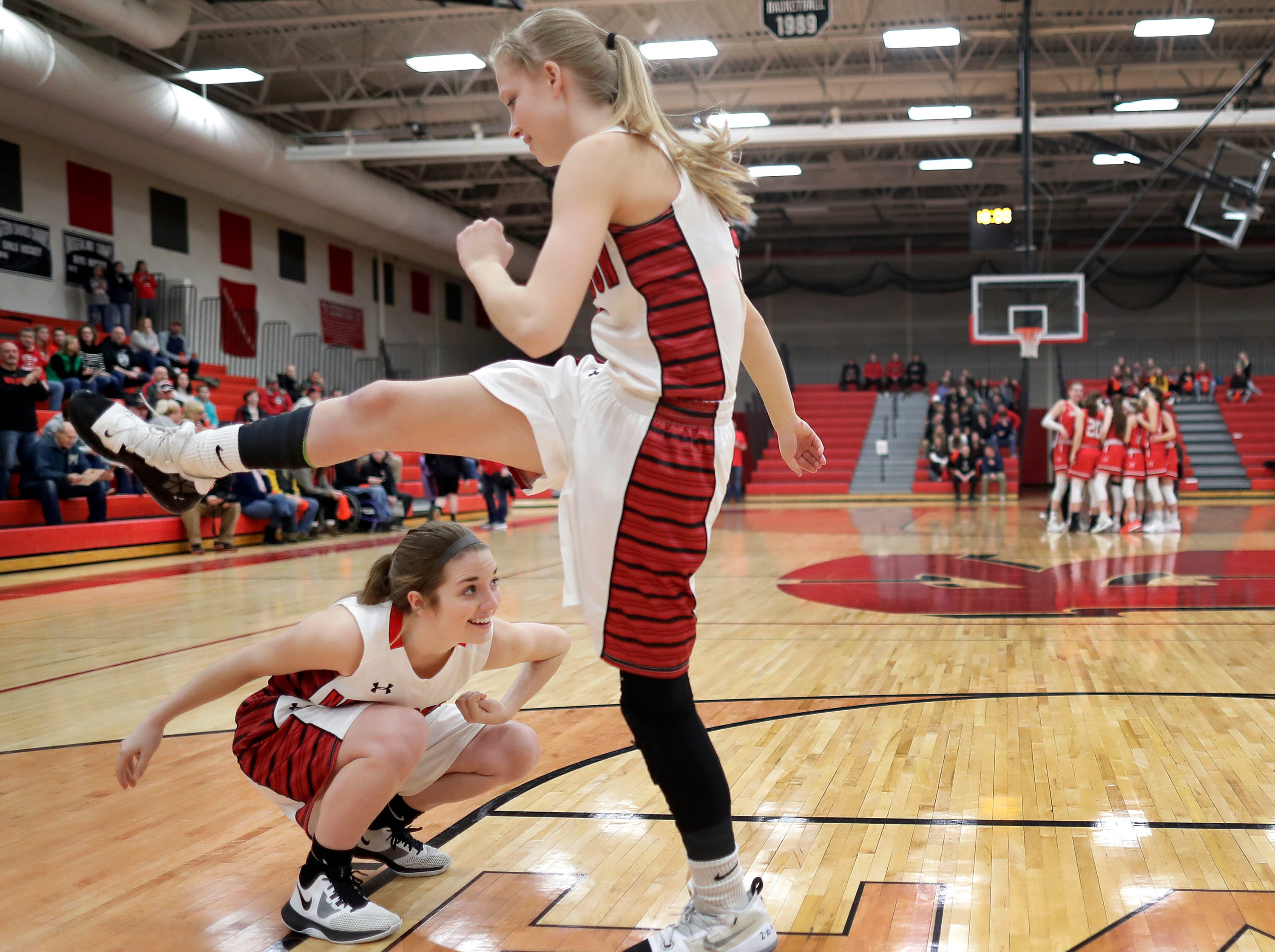 New London High School's #5 Tess Ruckdashel, left, and  #3 Kate Christian against Hortonville High School during their WIAA Division 2 girls basketball sectional semifinal gameThursday, February 28, 2019, at Kimberly High School in Kimberly, Wis. Hortonville defeated New London 67 to 42.